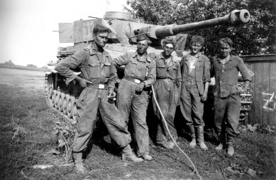 A tank crew from 2nd SS-Panzer Division Das Reich after the 1943 Battle of Kursk in Russia —the largest tank battle in history.
