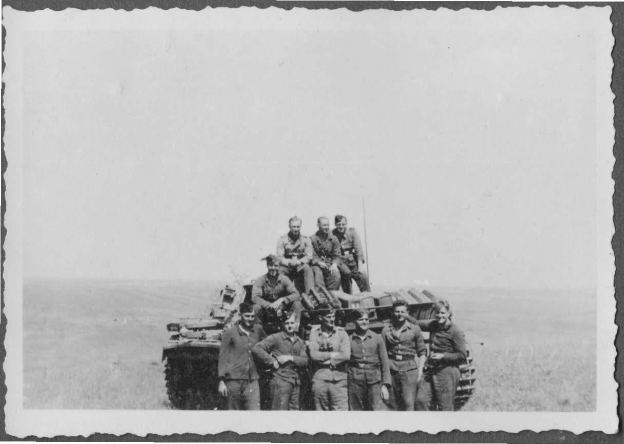 Several tank men of 2nd SS-Panzer Division Das Reich on the vast steppe during Nazi Germany's advance into Russia. Huber is recorded as sitting on the turret at left. His commanding officer Captain Karl Kloskowski is in the front row with arms crossed, third from left. Source: Rüdiger Warnick Collection.