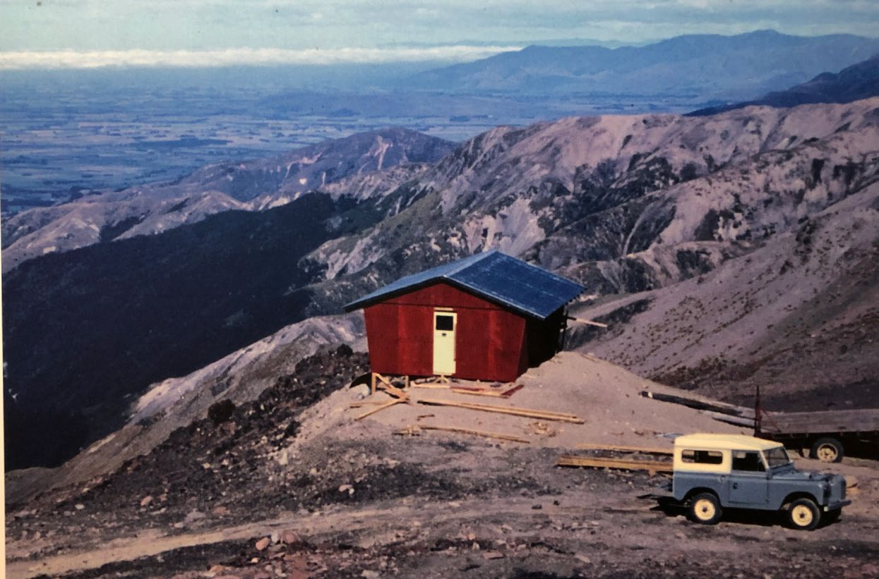 A photo of an image of Willi Huber's mountain hut under construction in the early 1970s