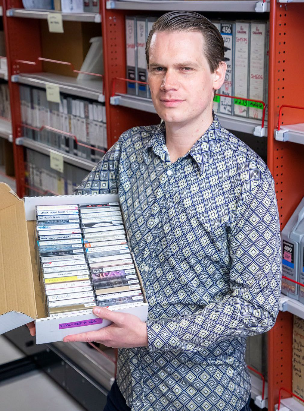 William Daymond with a box of Flying Nun tapes.
