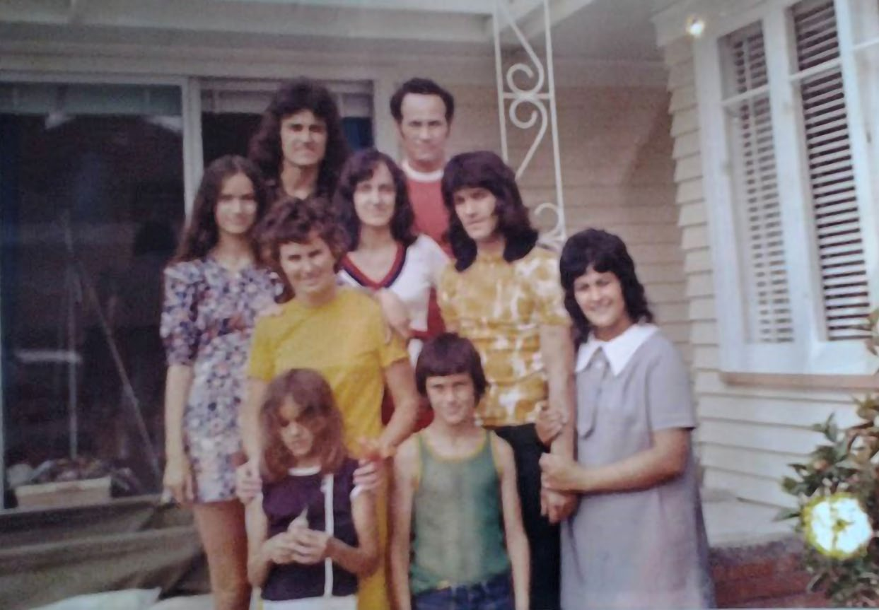 Mark Gosche (back left) in front of the home his parents purchased on a modest income with the help of a state-backed loan. Photo: Supplied.. The family was living in a one-room motel. Photo: Dean Purcell, New Zealand Herald.