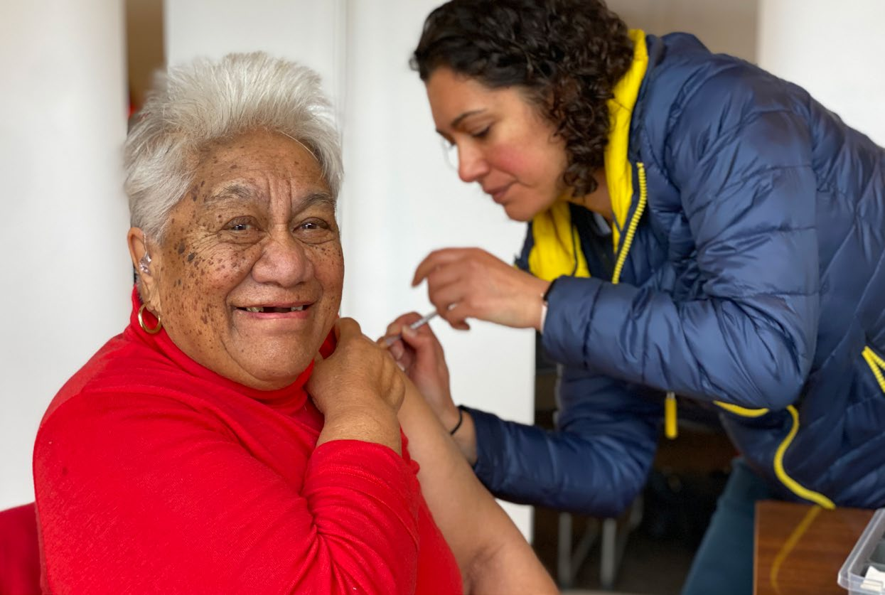 Dr Maia Melbourne-Wilcox administering a vaccine at Rehua Marae